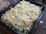 Sprinkle with some homemade dried parsley and mixed shredded cheese. Then into the oven!